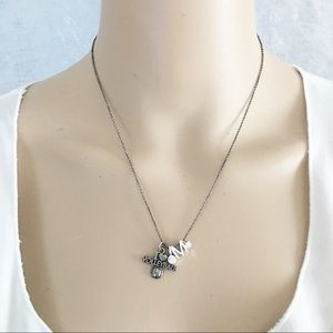Volleyball necklace with an M